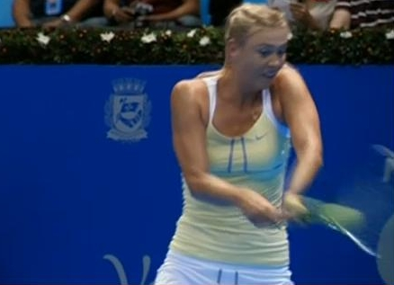 Sharapova backhand scrunched face intense hit racquet tennis ball Brazil South American photos