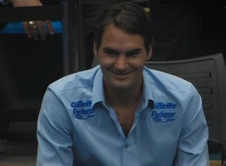 Roger amused smiling blue Gillette shirt photos