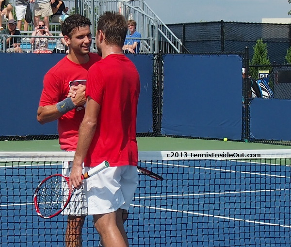 Stan Wawrinka Grigor Dimitrov practice Cincinnati 2013 hug handshake close bodies touching at the net photos pictures