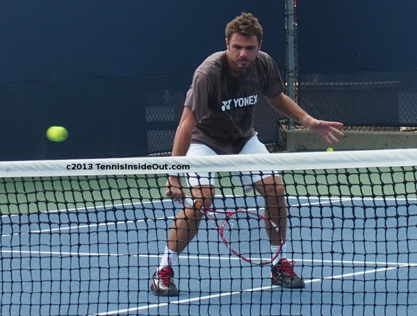 Stan Wawrinka volley at net hands tennis ball sexy sweaty practice Cincy US Open series pictures
