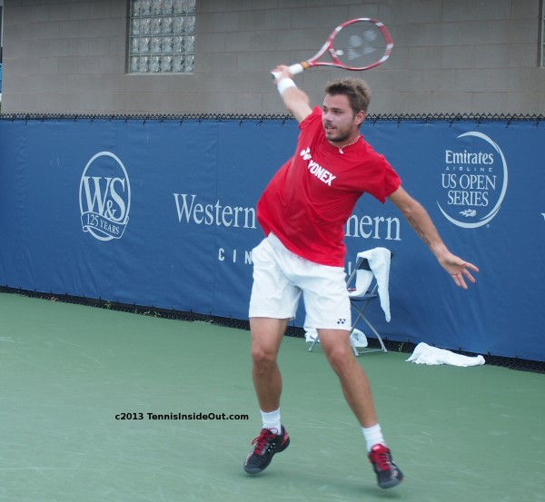 Stan Wawrinka Cincinnati US Open series stretching single handed backhand follow thru white shorts black tennis shoes red Yonex tee racquet hot sweaty photos 2013 semifinals