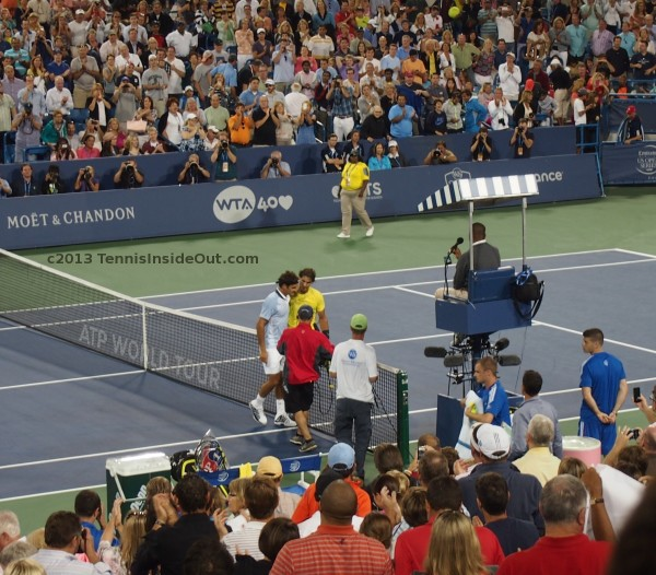 Roger Federer Rafa Nadal smoosh hug handshake at net Cincinnati Open Masters 2013 quarterfinal match tennis pictures photos screencaps images