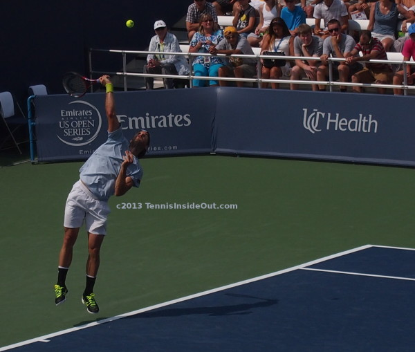 Leaping serve jumping after tennis ball Tommy Haas lovely legs
