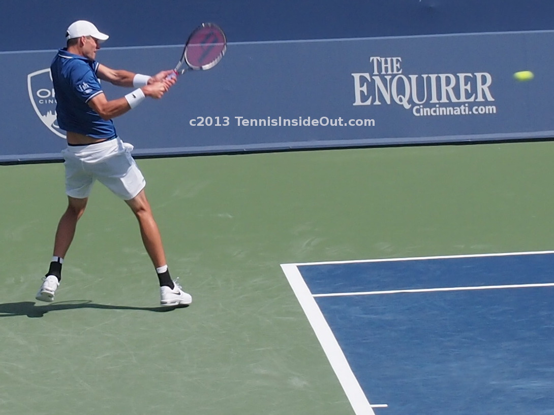 Big John Isner photos of backhand swing