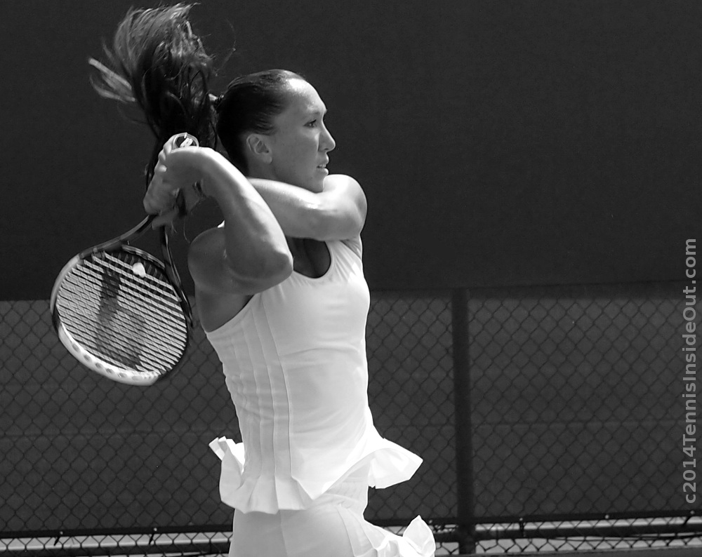 Jelena Jankovic practice Western and Southern Open Cincinnati 2014 black and white ruffled dress backhand swing flying ponytail photos pictures images