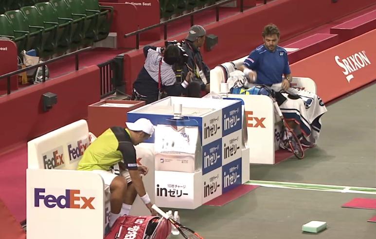 Tatsumo Ito Stan Wawrinka second round match changeover photos pics